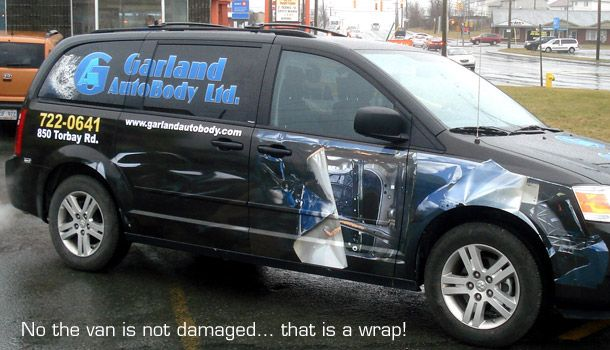 No the van is not damaged... that is a wrap! | Garland Van
